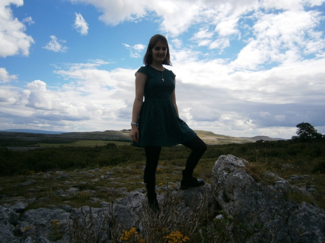 Miriam Joy on a rock in the Burren
